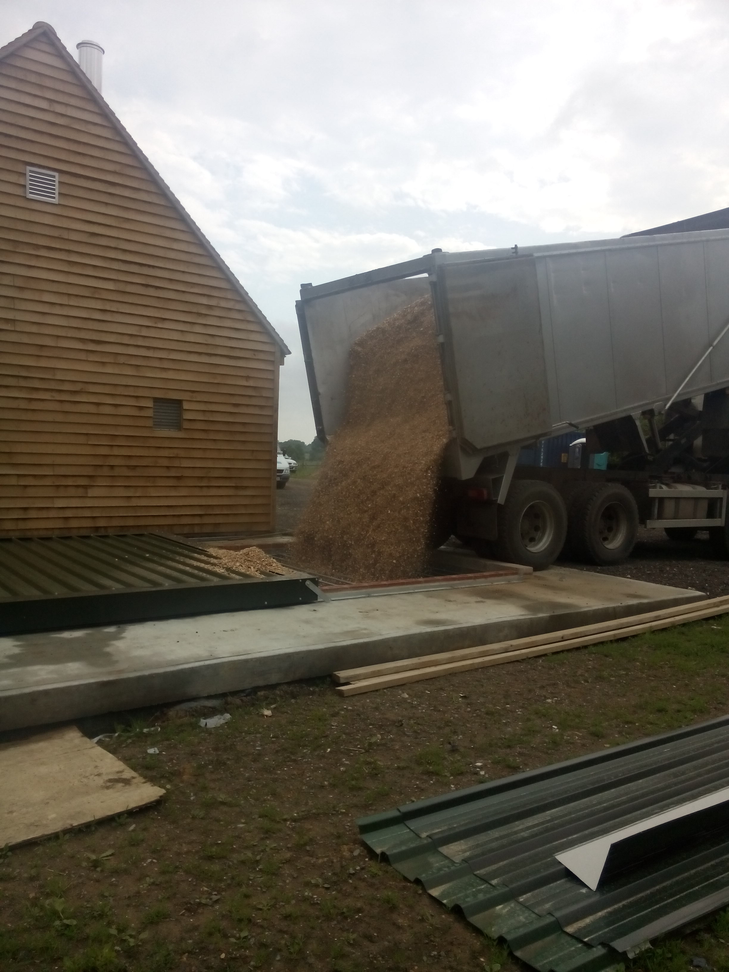 5 June 2015 - first load of wood chip being delivered into underground fuel silo